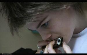 Sans Métro Fixe : scène de l'harmonica